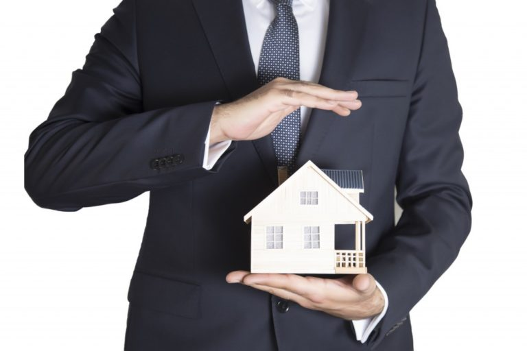 Man holding a house model